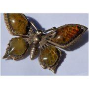 Bursztynowy motyl z mosiądzu